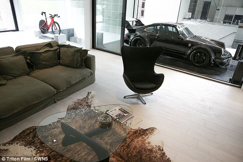 Thai man builds glass elevator in lounge to display his Porsche cars