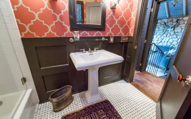 Includes a bathroom with shower space