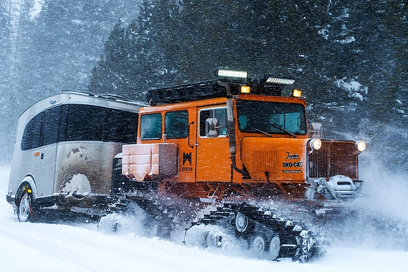 Airstream Basecamp paired with Sno-Cat for extreme snowboarding