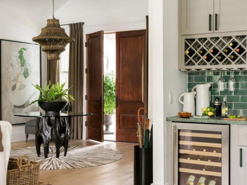 Wood beaded mini chandelier illuminates the foyer