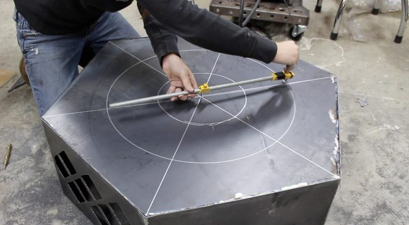 Drawing even-spaced drain holes in the fire pit