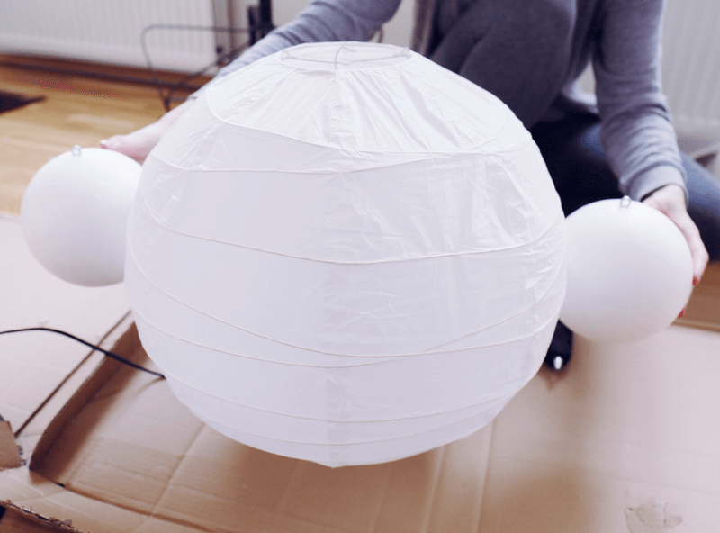 Glue both balls on two sides of the lamp