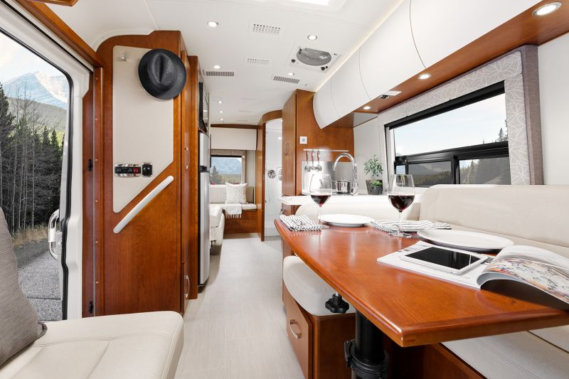Serenity travel van comes with convertible rear lounge and power sofa