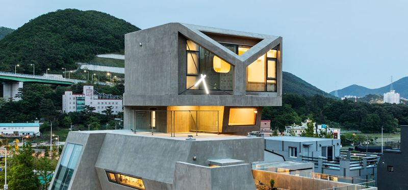 Moon Hoon builds angled concrete house in shape of an owl