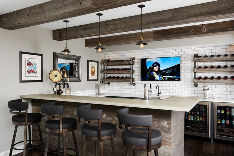 This remodeled basement features home theater and a steampunk bar