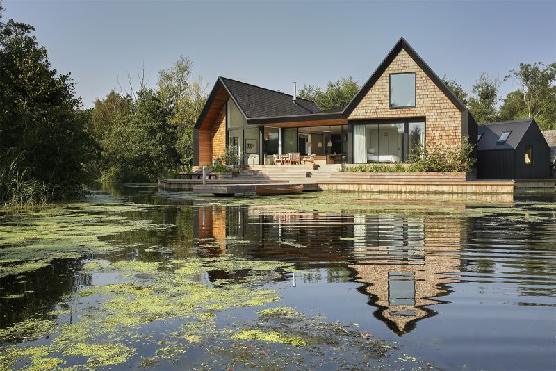 Backwater is a waterside house located across a private lagoon