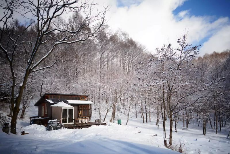 Daigo designs tiny off-grid cabin in Japanese woods