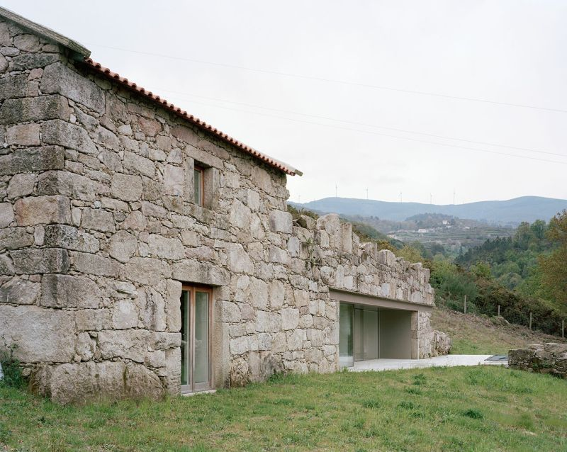 Old stone house in ruins transformed into modern vacation home