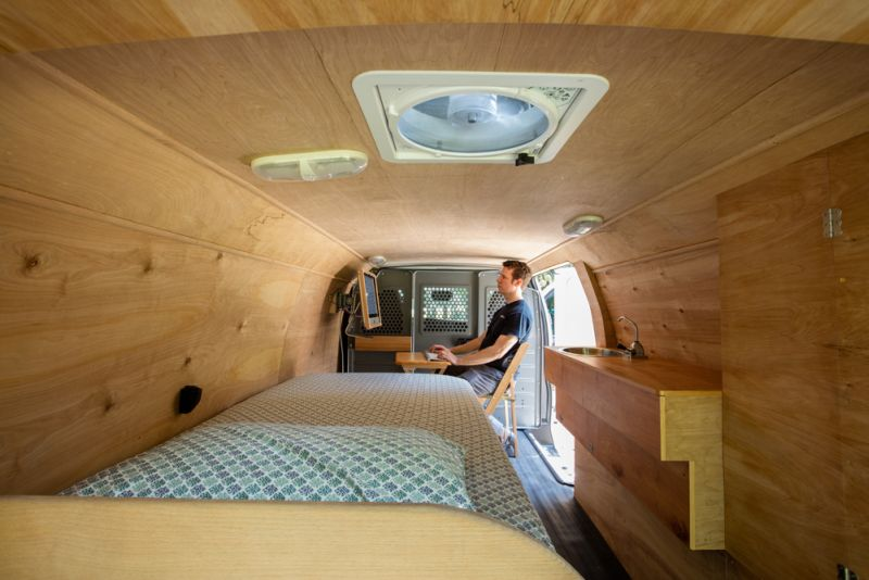 Ross Lukeman transforms cargo van into cozy home with office