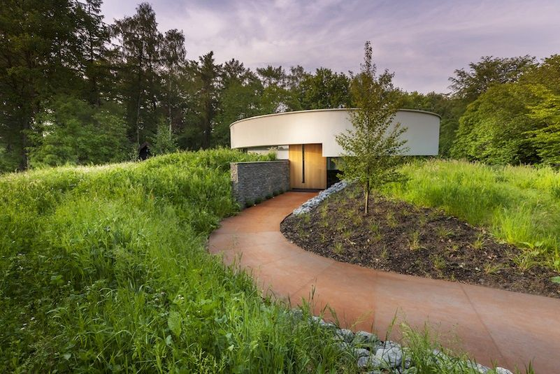 This circular house with big windows brings the outdoors in
