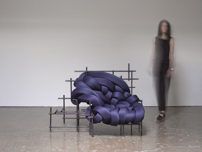 Lawless Chair by Evan Fay consists of foam ribbons interwoven in metal frame