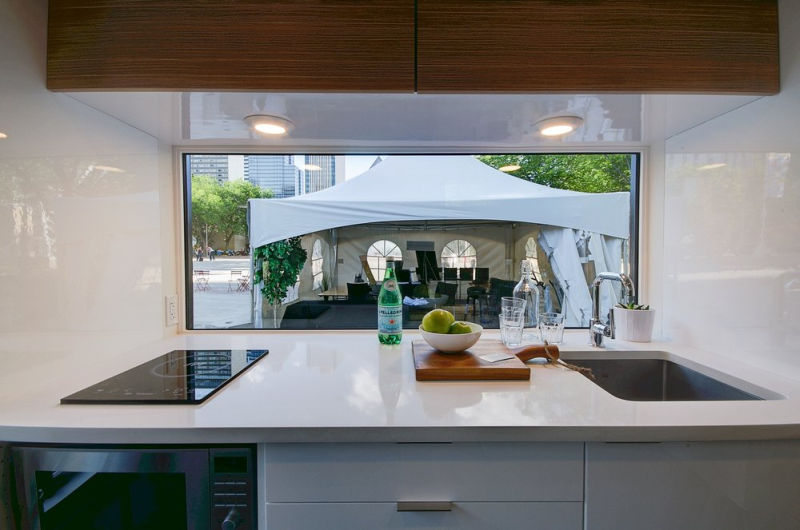 kitchen and bathroom areas are decorated with Quartz