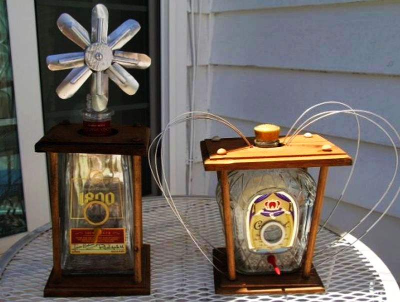 Liquor bottle birdhouses by Larry Keisling