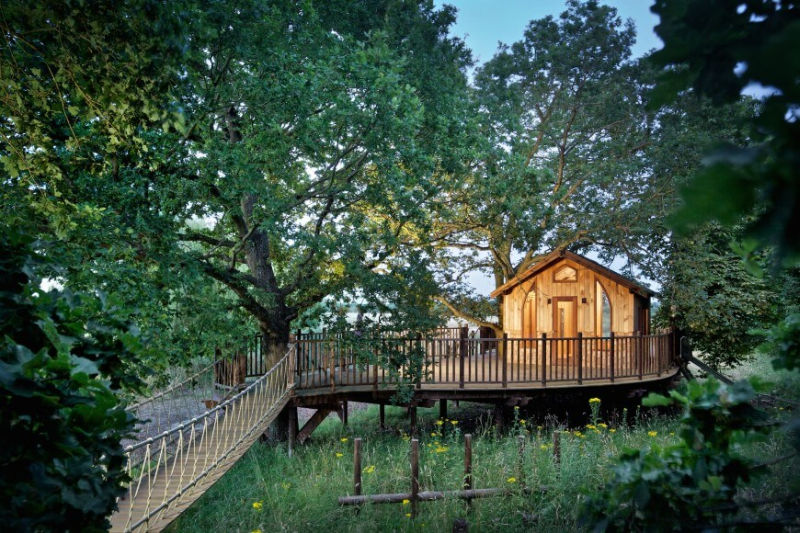 Nook treehouse in features sunken fire pit in the middle of amphitheatre seating