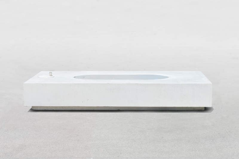 Jean Couvreur's concrete public bench features real water surface