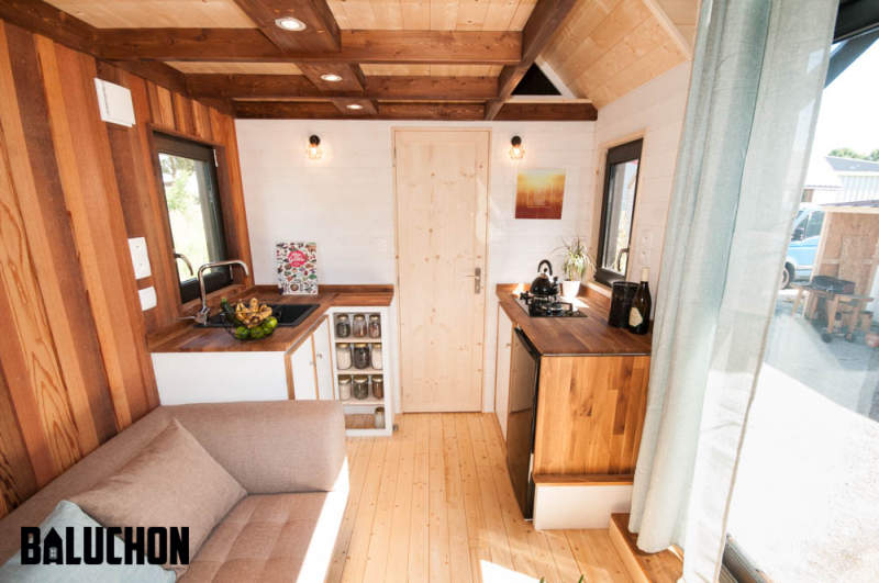 Ostara tiny house by Baluchon features two-leaf glass door