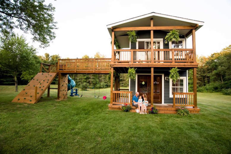 Michigan dad builds two-story playhouse complete with climbing wall and slide
