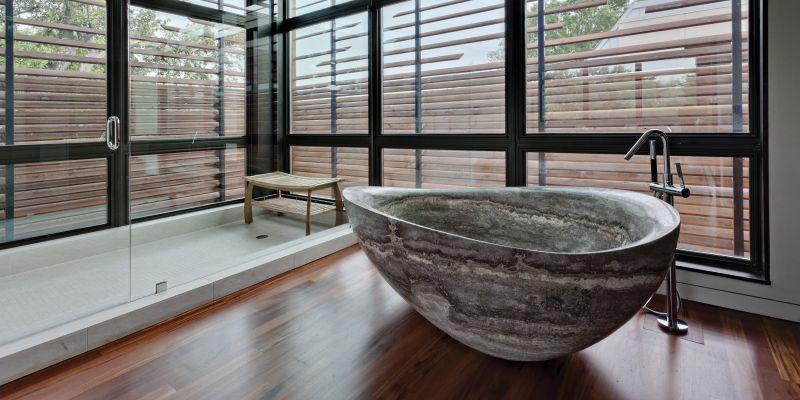 stone and wooden bathtub