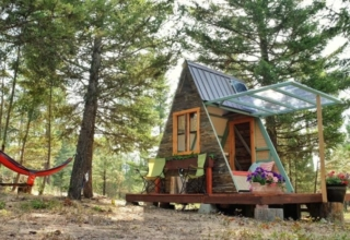 This solar-powered A-frame cabin features a retractable wall