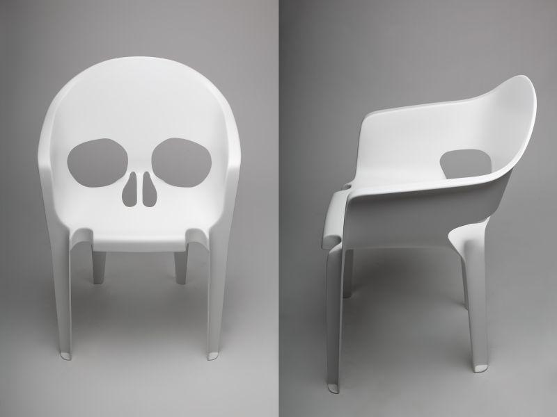 White fiberglass skull chair by pool