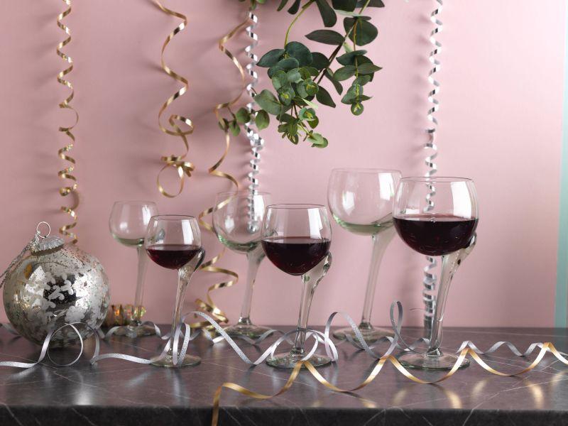Asymmetrical recycled wine glass