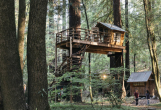 This boho style cabin comes with its own treehouse, zip lines