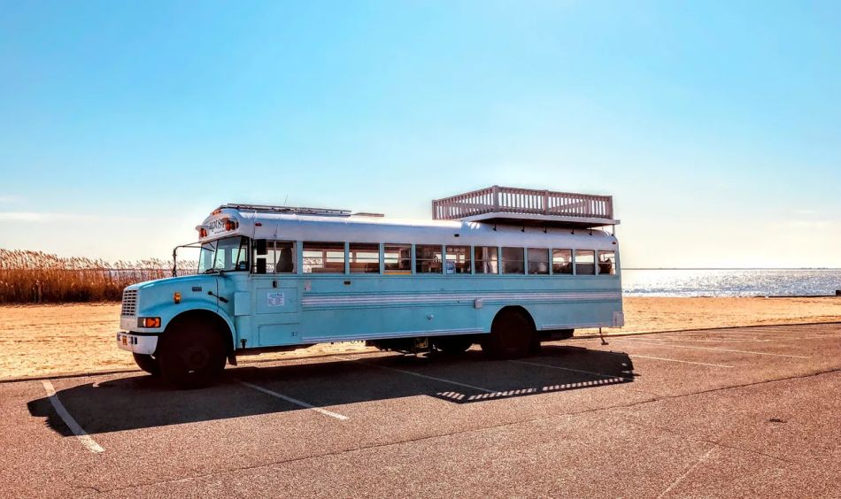 Apt84 is School bus Tiny house on Wheels hosts Tours, Events and Weddings