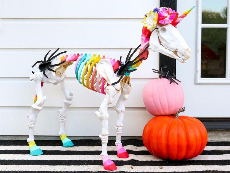 Rainbow Skeleton Unicorn Grazing in Yard - Outdoor skeleton decoration ideas