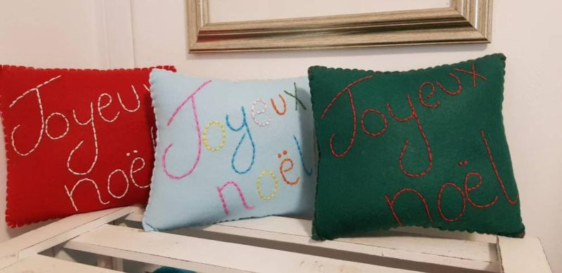Christmas-themed embroidered cushion covers