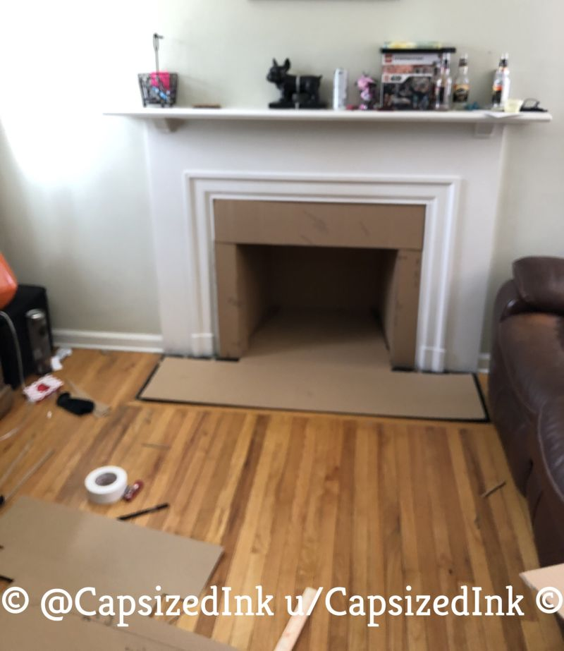 Redditor Turns Empty Fireplace into Little Dog Condo