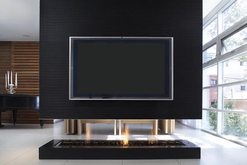room-divider-with-fireplace-recessed-television-by-Cecconi Simone