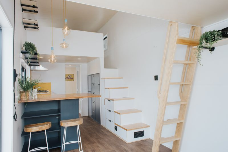 Tiny House with Cat-Friendly Interiors and Two Lofts