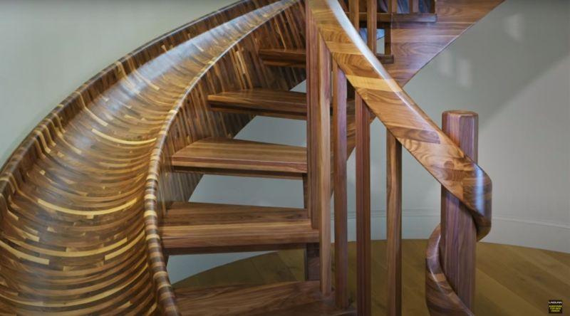 Top Tread Stairways Builds 33-ft-Long Curved Staircase with Slide