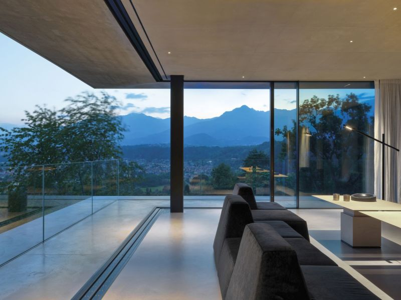 This Private House in Biella Hills, Italy Seamlessly Blends into Surrounding Nature