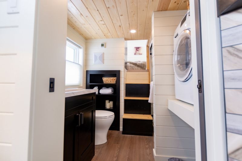 Phoenix Tiny House on Wheels Features Overhanging Loft Bedroom