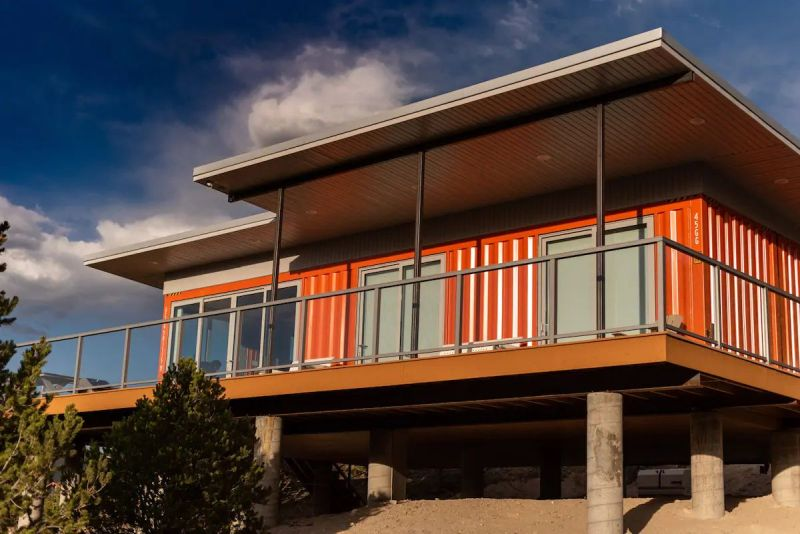 Nestled in the foothills of the Sangre de Cristo Mountains, this orange shipping container rental home is a cool getaway near Salida, Colorado
