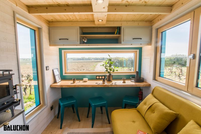This Tiny House Features Netted Floor to Connect Loft Bedrooms