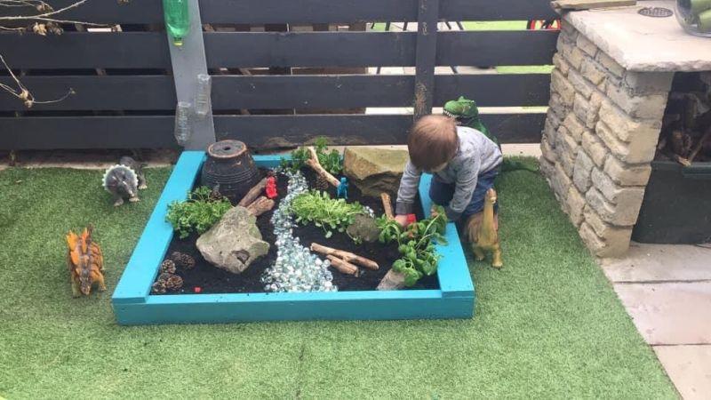 Mom Builds Impressive Dinoland for Her Son in Garden