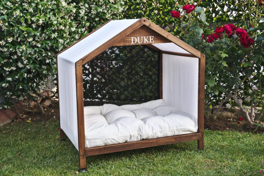This Fancy Outdoor Dog House is Made of All-Natural Materials