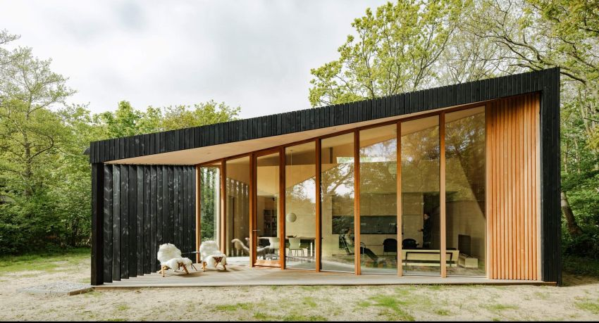 Orange Architects Builds Wooden Holiday Home with Transforming Interiors